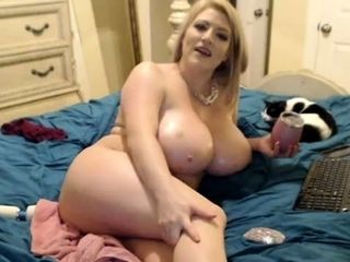 Big-titted blond mature getting off with sextoy