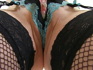 Hot red British MILF stuffing her panties in her pussy