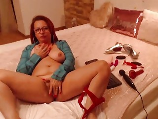 Mature redhead with saggy titles masturbates while in her bedroom