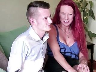 Busty redhead MILF on a 18yr old guy