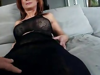 Mature Redhead wearing Boots is a Slut