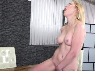 Blondie with big tits fucking herself with dildo
