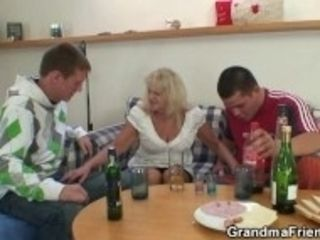 """Partying studs seduce elderly platinum-blonde into threesome"""