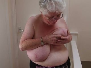 Check out brief haired mature tart in glasses who plays with her hefty bra-stuffers