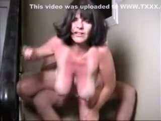 Huge-boobed wifey on the stairs