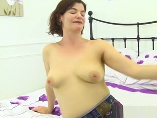 English cougar Josie decorates her fur covered puss with pantyhose only