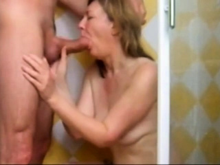 Mature landlady sucking in shower