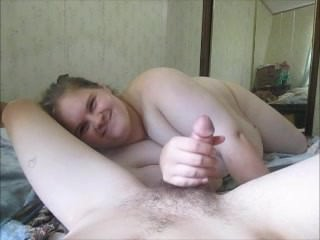 Cheating wife give friend a handjob in hubby bed while he gone