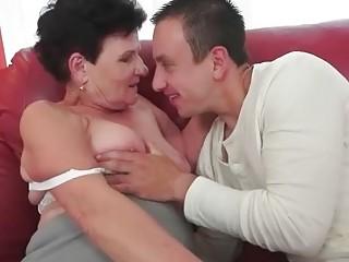 Boy fucks busty granny on sofa