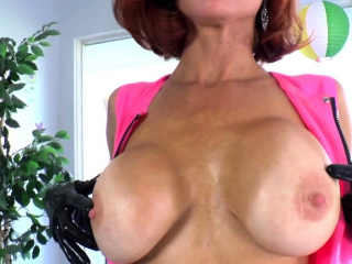 Cougar in strap on dildo thumbs