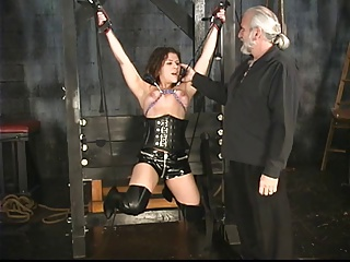 Stunning brunette bdsm victim gets her tiny tits tortured in the sex basement