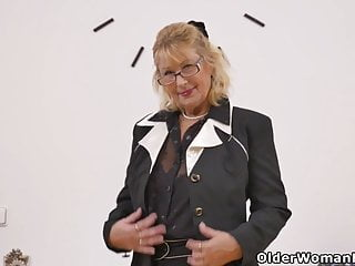 Grey-haired gilf Zosya from Russia finger pounds her beaver