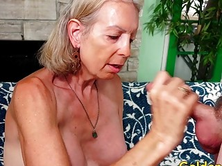 GILF supah handsome delights a junior paramour with Her throat and senior cunny