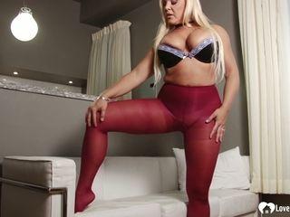 MILF in pantyhose displays her smoking legs