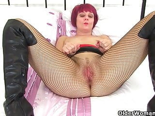 English cougar Skyler is frolicking her clean-shaven and cream colored muff