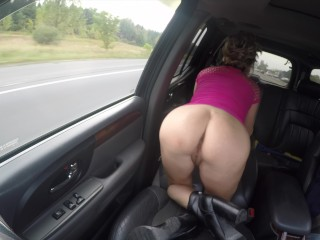 Elastic arse cougar in brief miniskirt high-heeled shoes showcasing vulva on highway!