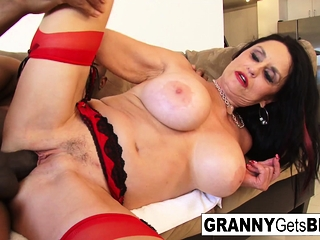 Big-boobed dark-haired grandmother takes the ebony wood in her moist puss