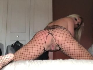 Mischievous cougar In pantyhose And undies Plays Solo
