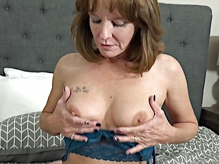 Mature brunette plays with double ended dildo in both holes