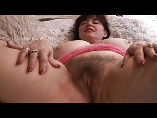 Busty hairy mature babe in mini skirt