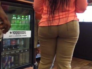 Gigantic dark-hued backside and hips suntan stretch pants