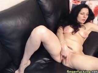 Mischievous cougar fingerfucking her wooly slit on cam