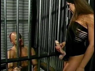Hot brunette rams poor guy with strap-on in jail