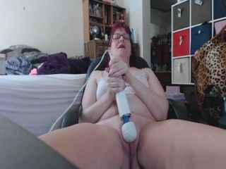 Mature sandy-haired uses a massager to make herself jizz real firm