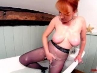 """""""Red XXX playing with her pussy while in pantyhose"""""""