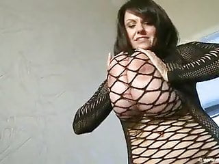 Monstrous boobies Mature in Fishnet sundress Posing Around the palace