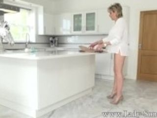 """Lady Sonia stroking on the kitchen counter"""