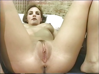 Hot bitch gets oily and masturbates in bed